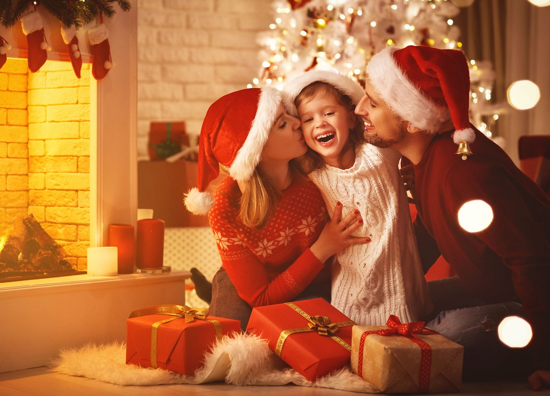 Merry Christmas! happy family mother father and child with gifts near tree